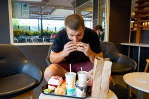 Man eating macdonalds