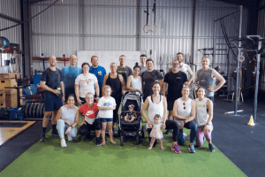 group of men, women, and children which train in gym