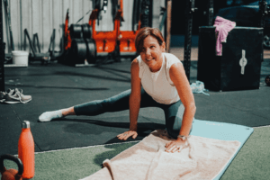woman stretching for mobility in fitness gym