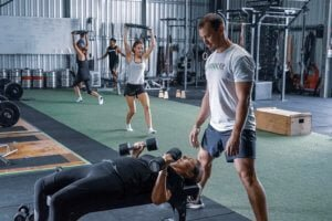 group strength training with weights in gym