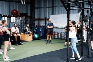 trainer demonstrating technique for fitness gym group